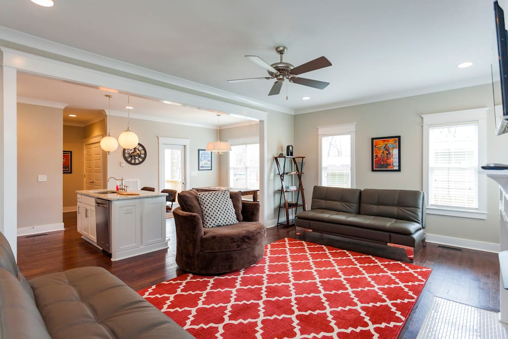 The Living Room seating includes a 360 swivel chair and two leather futons.