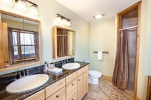 Downstairs Ensuite Full Bathroom with Double Granite Vanity, Jetted Tub, Separate Shower