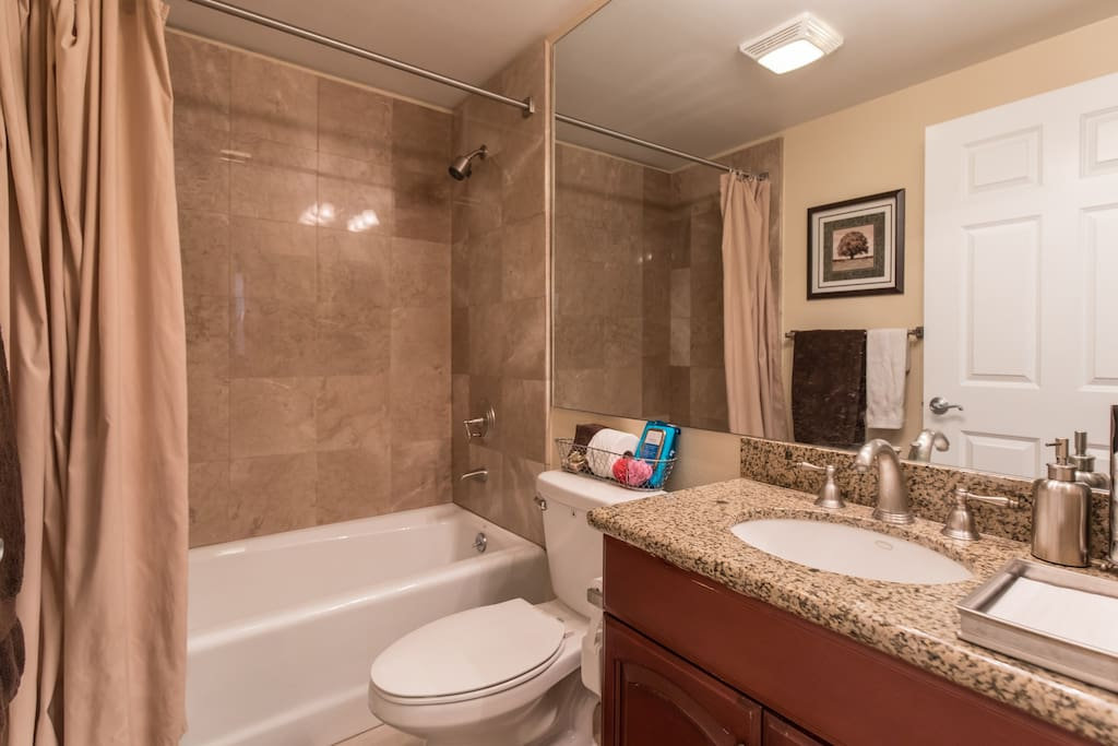 Private bathroom located about 4-5 steps away from bedroom.  Robes provided.
