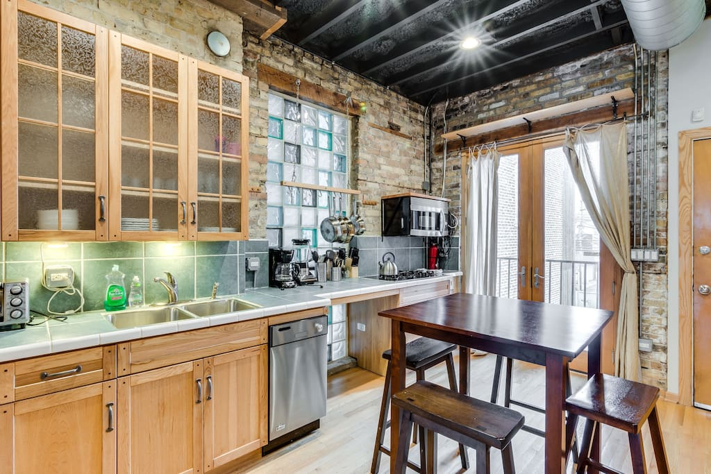 The exposed brick and wood cabinetry gives the apartment a very industrial feel