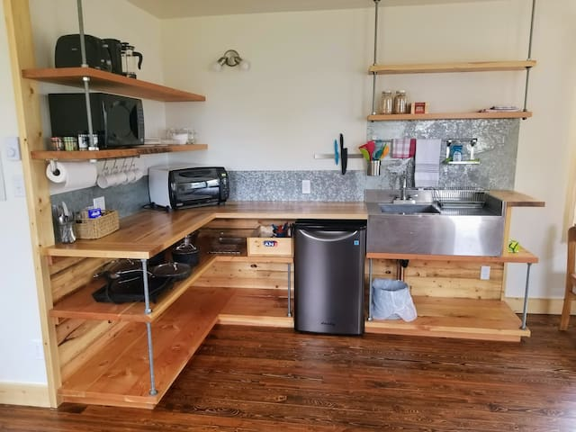 Kitchenette with microwave, mini fridge, hotplate, cookware, convection oven, electric kettle, French press coffee maker, toaster