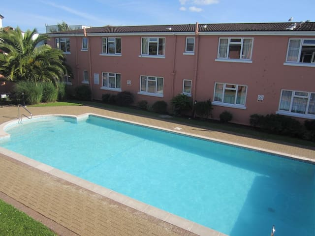Sunny seaside apartment with outdoor heated pool.