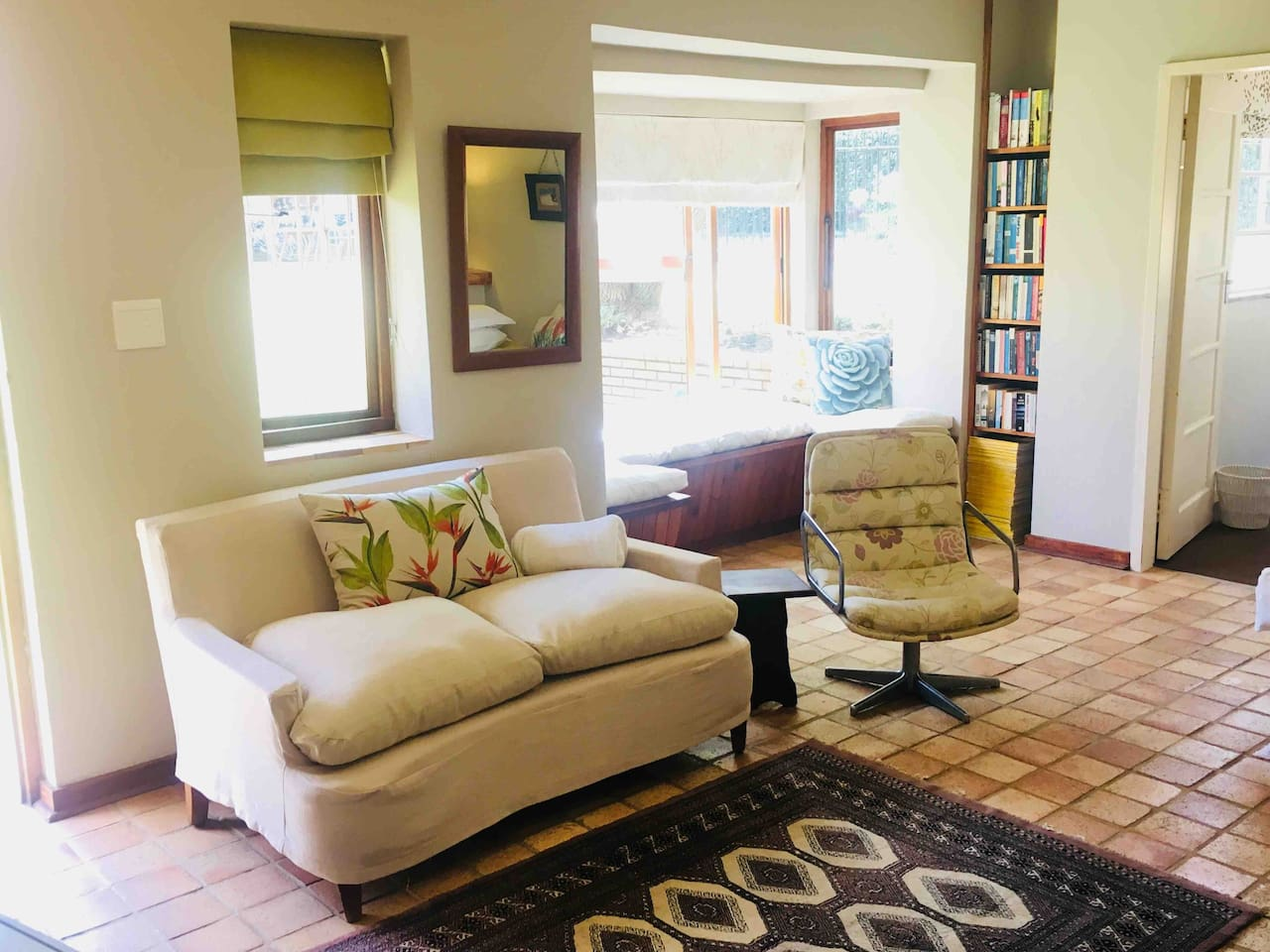 Lounge and reading nook with view of the garden