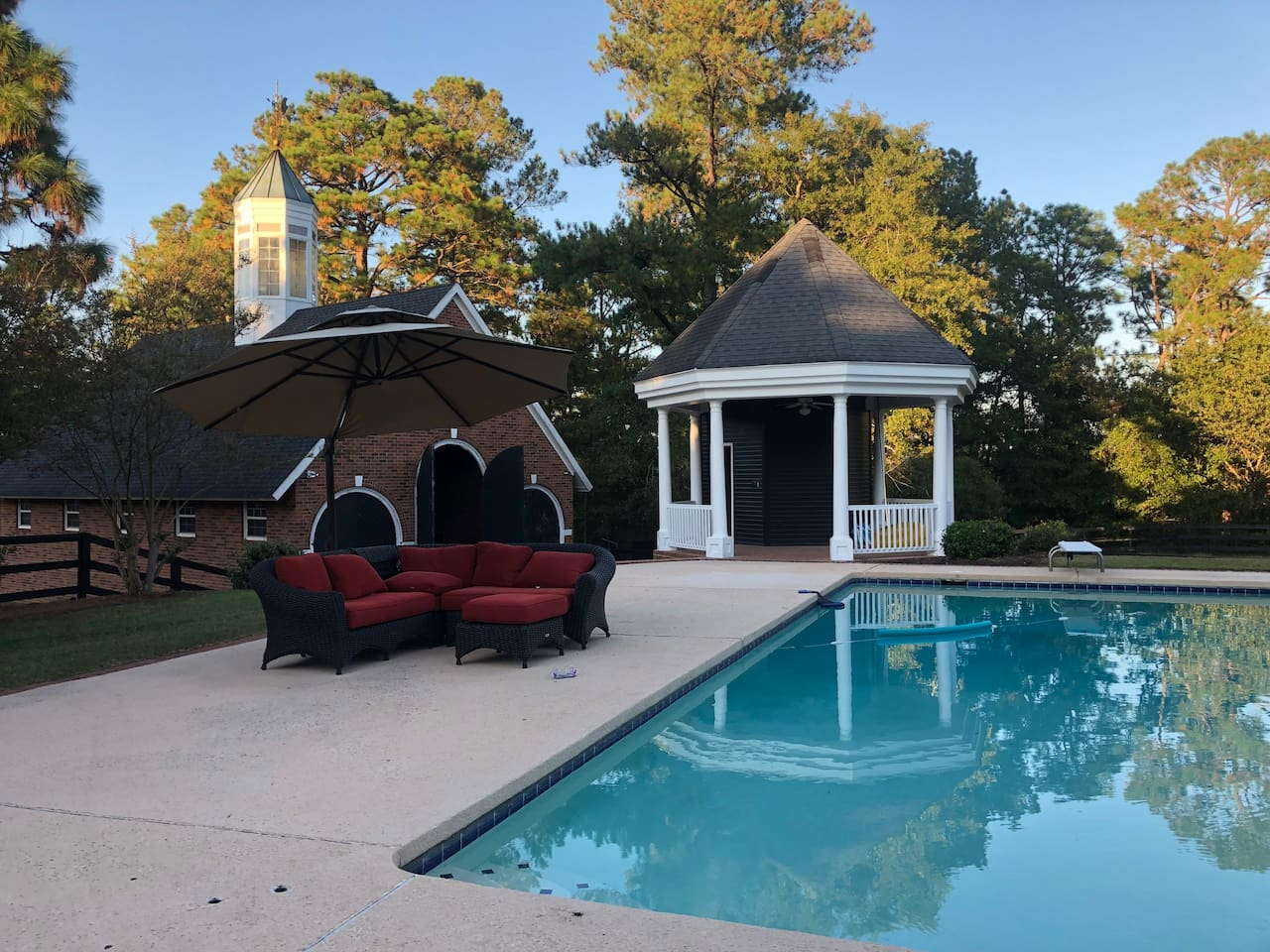 View of the barn, gazebo and pool from the main house (the carriage house is to the left just out of view)