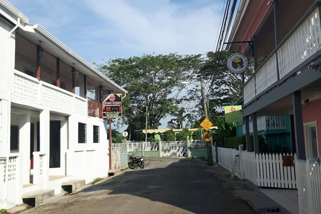 D's Guest House (left) located in front of popular restaurant (right)