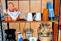Baked goodies, coffee, tea, drinking water and hot cocoa waiting for you.