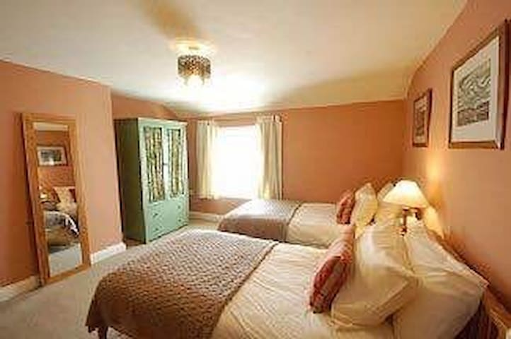 Full size single beds in both twin rooms.  All beds have quality cotton bed linen