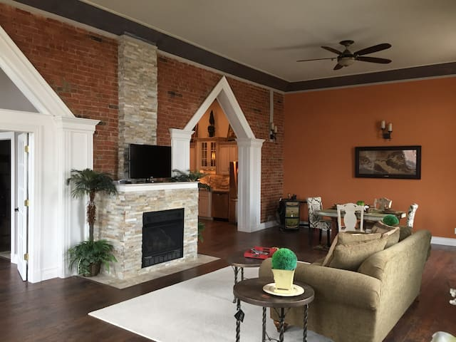 """Great room has 80"""" ceiling fans and custom moldings"""