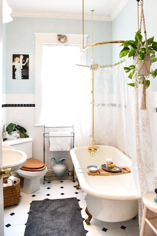 The Dreamy Bathroom:  The gorgeous  clawfoot bathtub / shower is the treasure of the vintage guest bathroom.