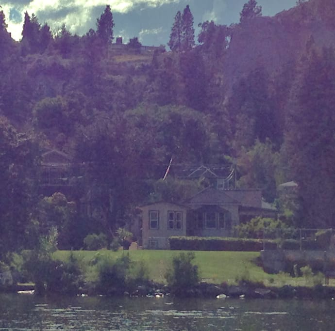View of our house from the lake.  Enjoy 5 km of lake shore walkways from in front of our home.