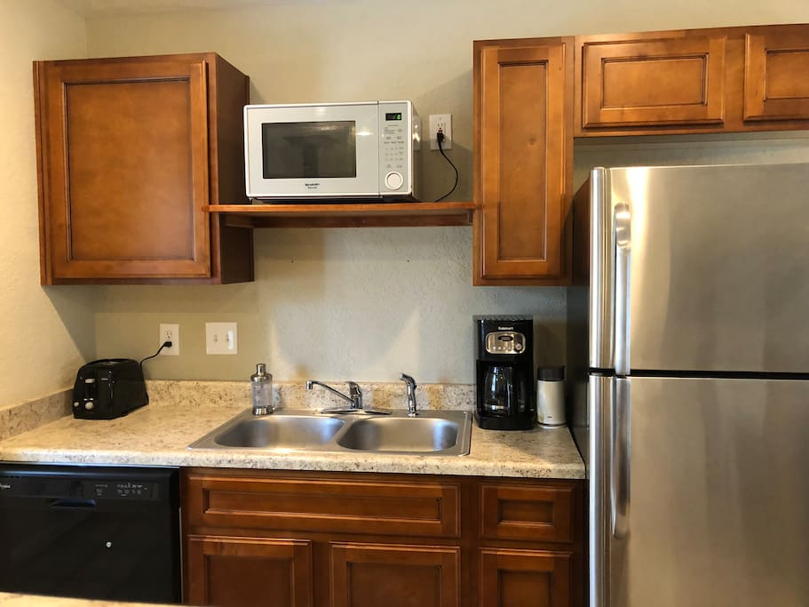 Full kitchen includes: fridge, dishwasher, coffee maker & grinder, microwave, oven/stove and all the cooking tools you need!