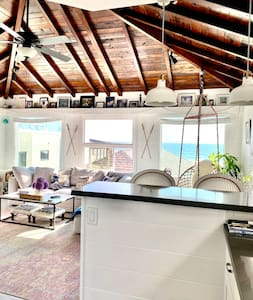 Ocean front beach bungalow on the Strand.