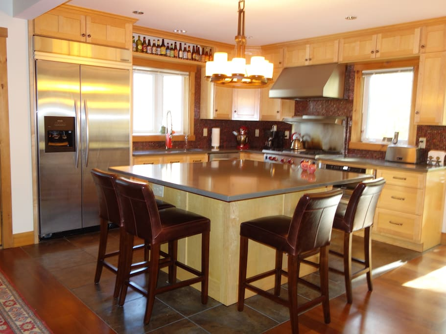 Gourmet kitchen with stainless-steel appliances and quartz countertop