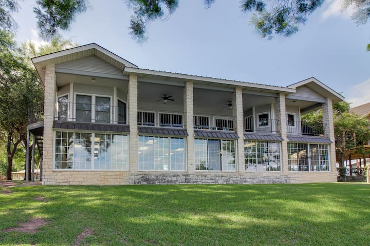 Dog-friendly waterfront home w/ heated pool, boathouse, and dock w/ boat lift