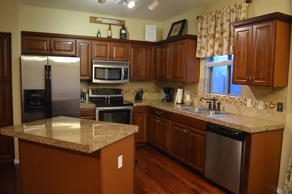 Kitchen - includes all dishes & small appliances. Patio with grill off kitchen.