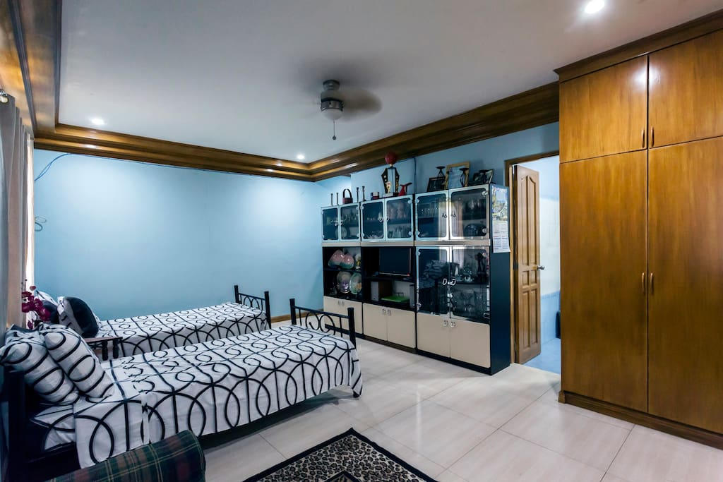 There are two twin beds.  This bedroom has a spacious bathroom and an access to an outside patio.  There is stepper and a treadmill for morning exercise.