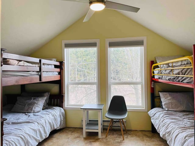 Bedroom 2 has 2 sets of bunk beds and beautiful windows.