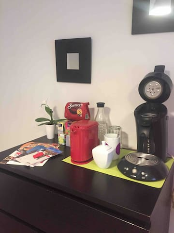 A coffee maker and a kettle is waiting for you in the room. Please bring your own coffee pads for senseo with you. I have some kinds of tea available.