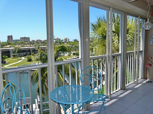 Peaceful waterfront condo a short walk from beaches, shopping, and boating