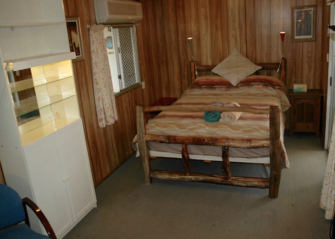 Queen room with own kitchen and bathroom.