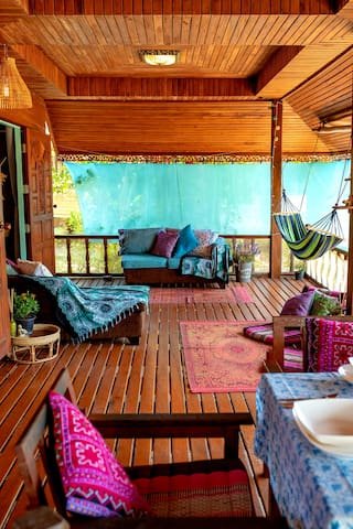 Beautiful lovely large terrace filled with love. Sofas, hammock, dining table and chairs, chill out triangle cushions and a lovely ocean view ❤️