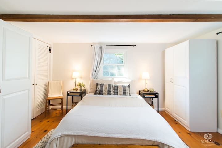 Ground floor guest room with full sized bed and a half bath.