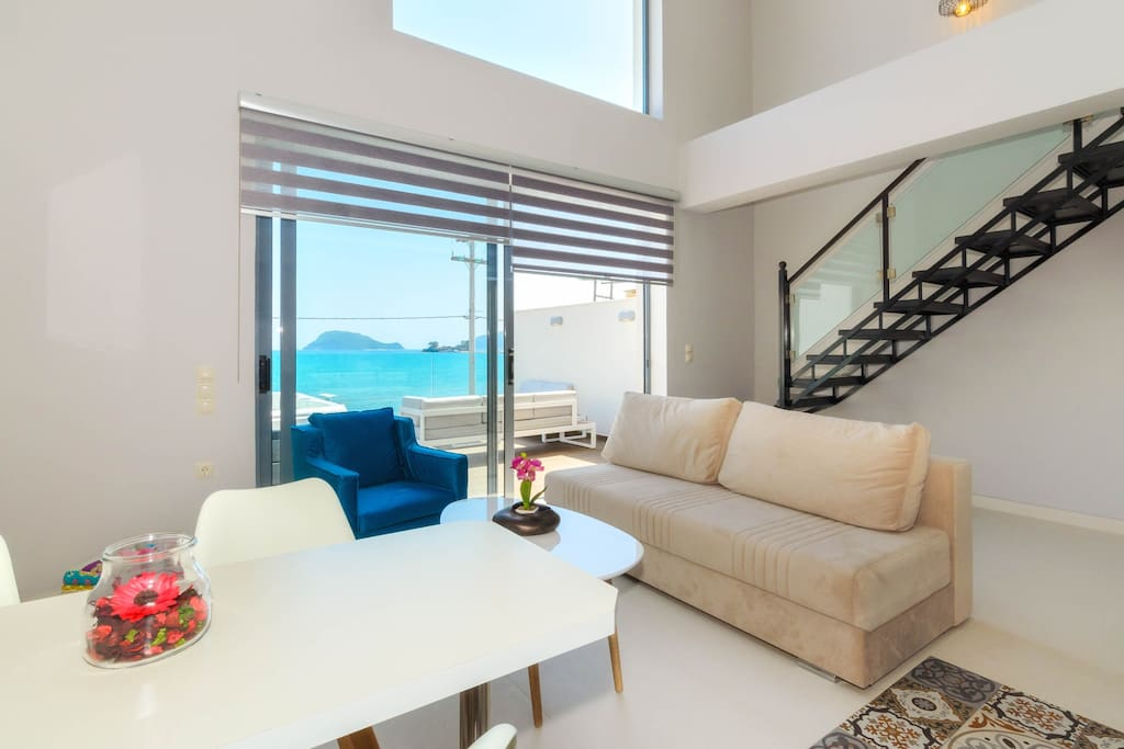 Living room with balcony overlooking the beach