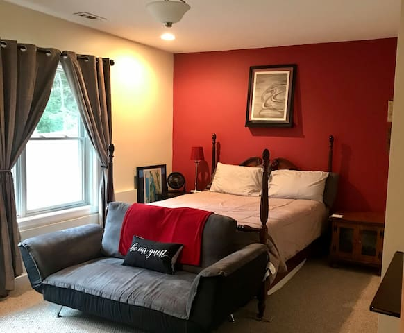 This is a 14x15 bedroom with a queen size bed and a futon that folds down into a twin. This room also has a full size desk for any work related tasks and still plenty of room to move around.