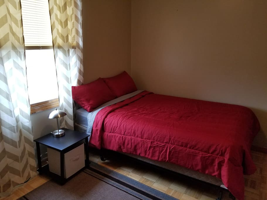 Bedroom with double bed and large closet.