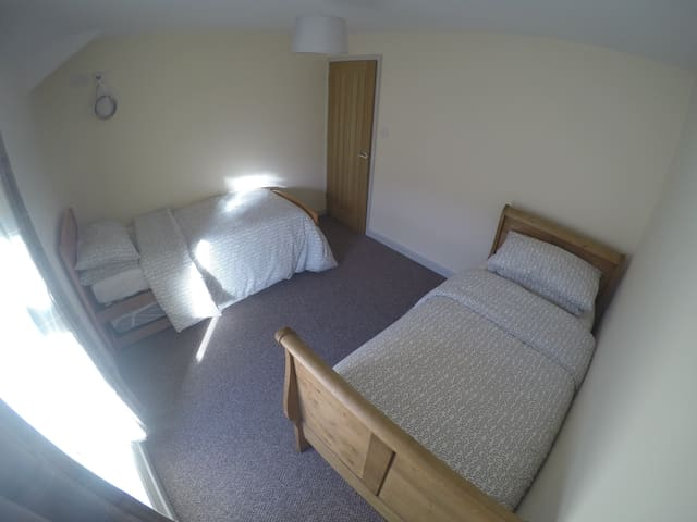 Two Single Beds with Pull-outs