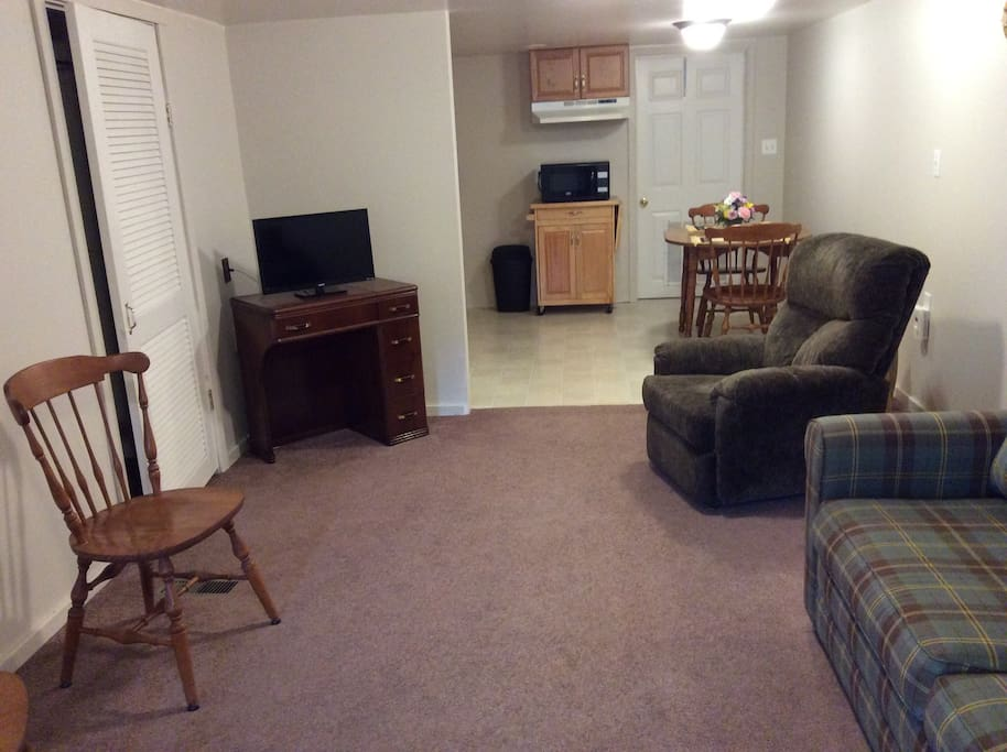 Living room with 2 recliners and tv