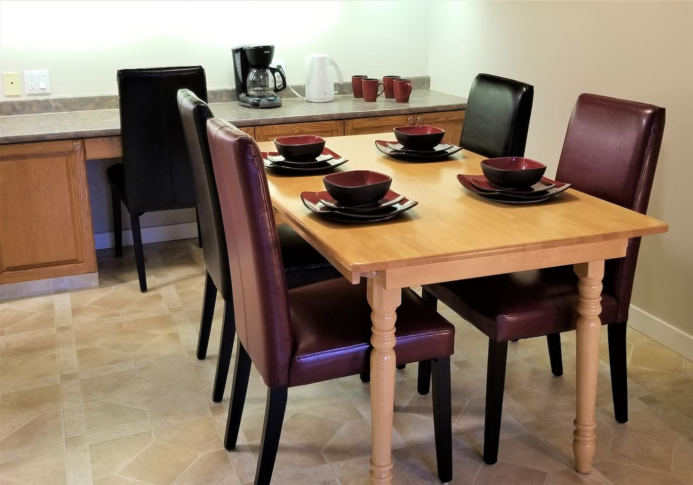 Dining room features coffee bar and seating for up to six.  Relax and enjoy a glass of wine while you talk about your experience at WEM (West Edmonton Mall)