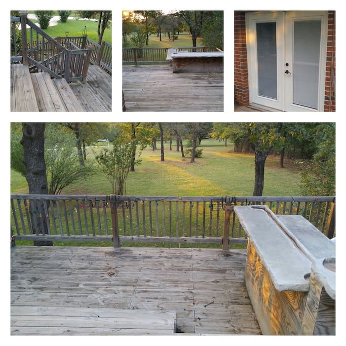 Entry Staircase and Front Door.  Beautiful two-tiered deck with seating and outdoor grilling area with bar.  Relaxing escape from the day and enjoy the evening as the deer stroll across the 5 acre property.