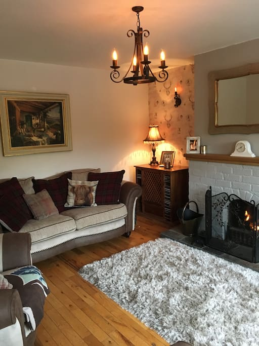 Enjoy our cosy sitting room with an open log fire.
