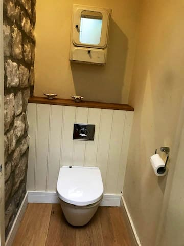 Downstairs loo on ground floor, to save you going upstairs to bathroom in the night or early morning!