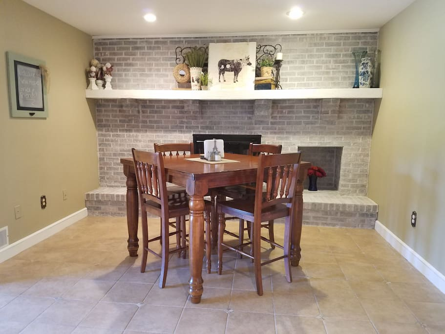 Eat-in kitchen with high top/bar height table with seating for up to 6 guests