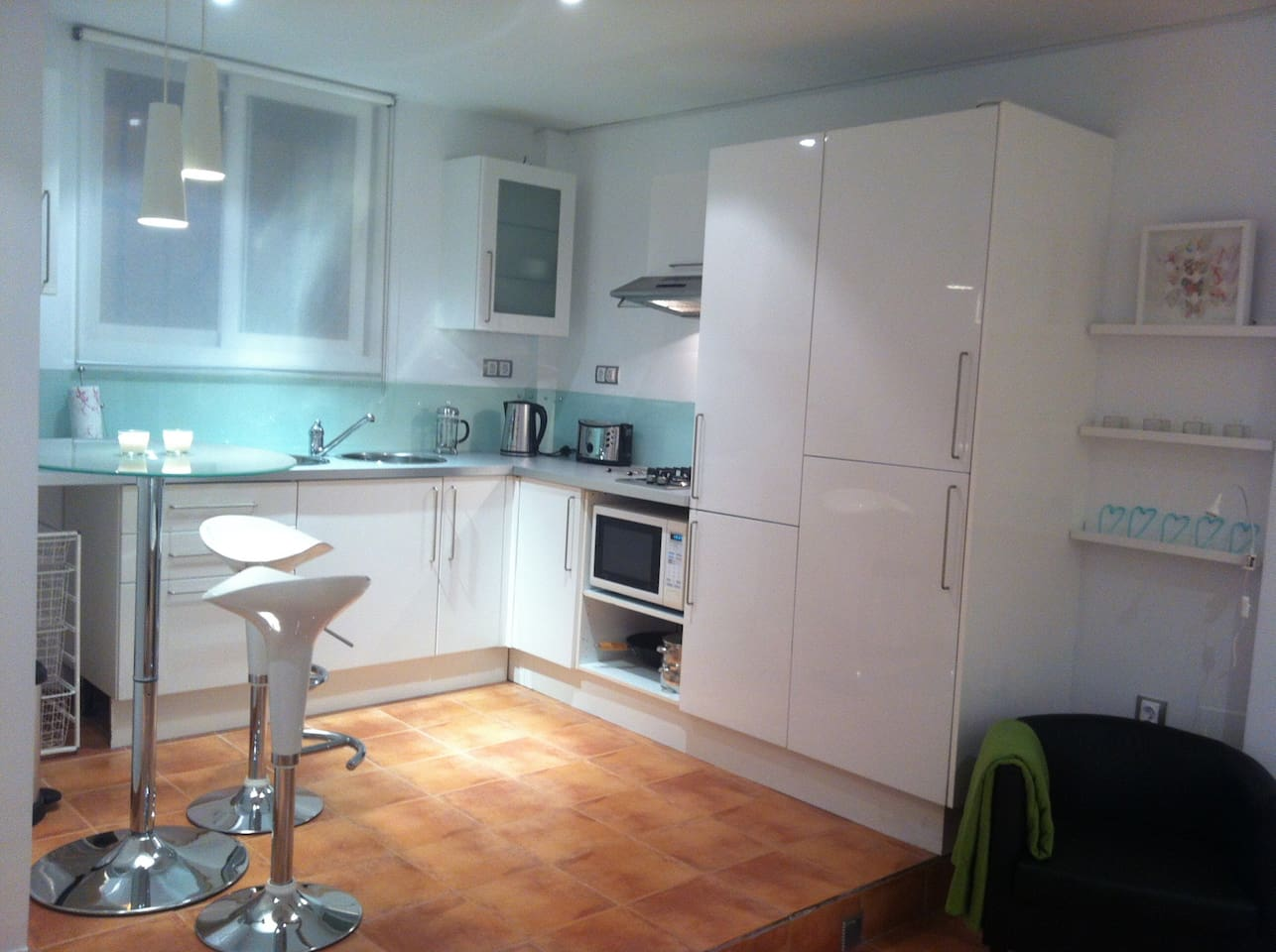 Modern well equipped kitchen with 'breakfast' table and stools