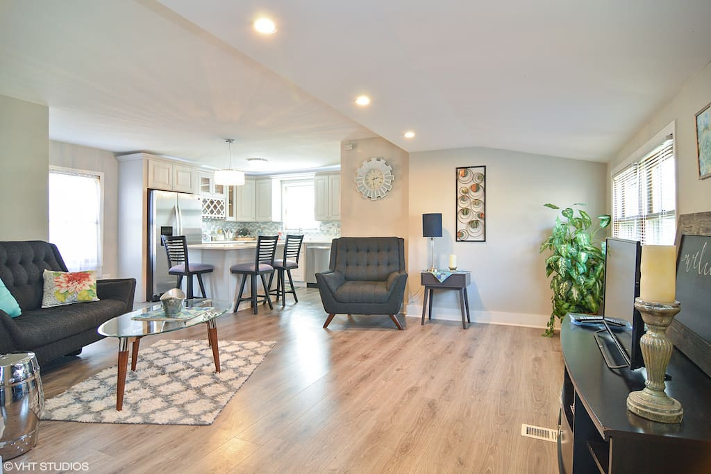 Beautiful open concept living room leads into kitchen