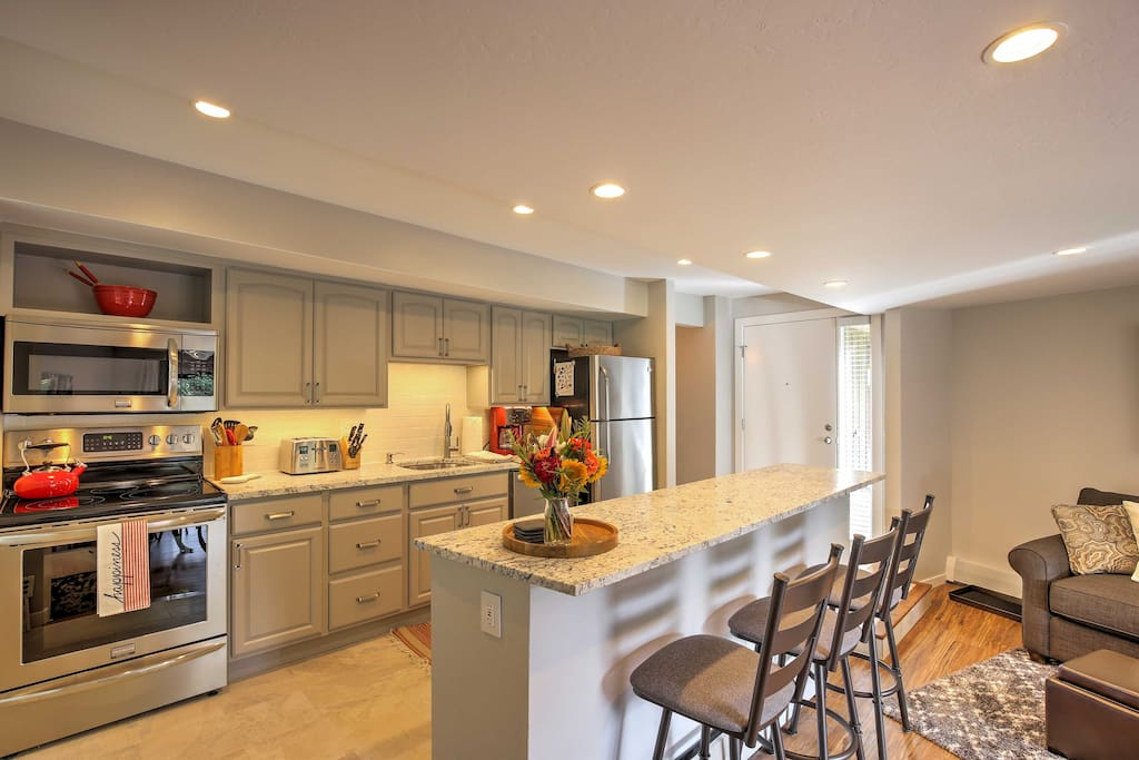 Look forward to cooking meals and snacks in the fully equipped kitchen, with stainless steel appliances and barstool seating at the island.
