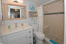 Bathroom is completely renovated.  Bright LED lighting makes applying your makeup a breeze.  Roomy walk in shower also features two spray heads and a seat for your safety and comfort.