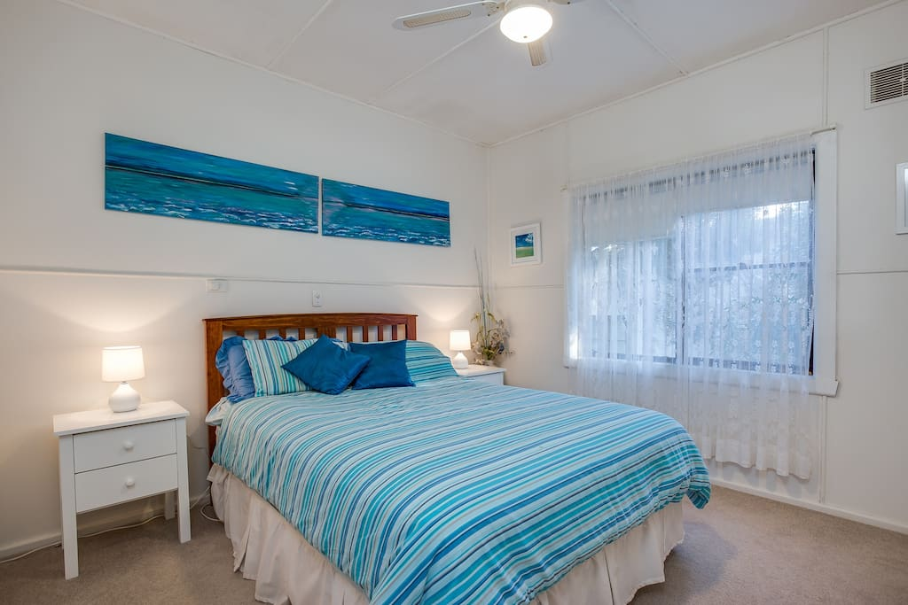 Main bedroom with queen size bed & ceiling fan