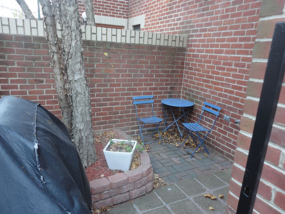 Gas grill and pub table/chairs on patio