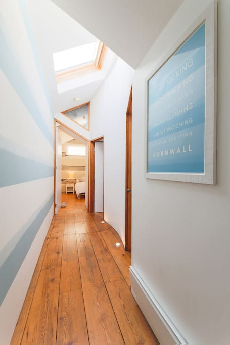 Hallway - love the floor lights, the skylights and the wallpaper - view into bedroom one