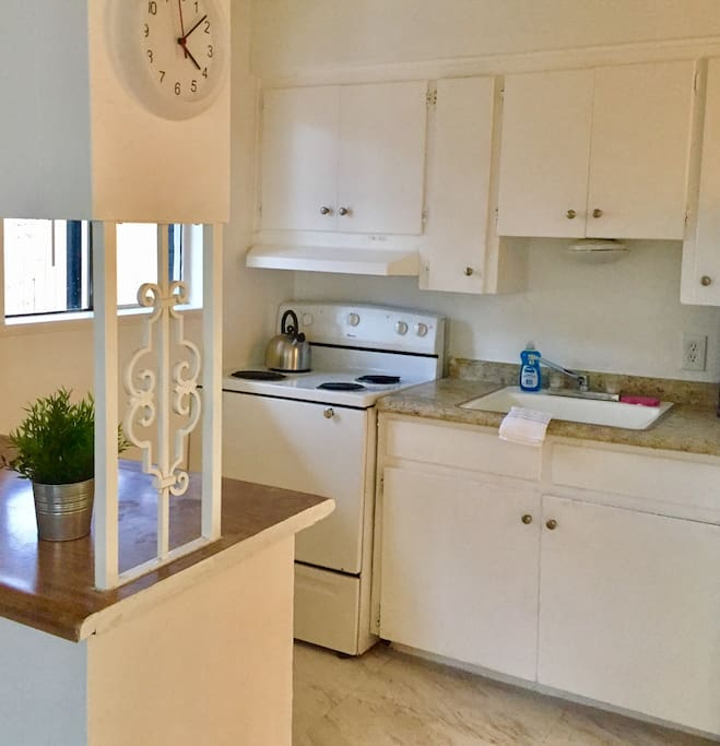 Full kitchen with stove, fridge, microwave, coffee maker and coffee!
