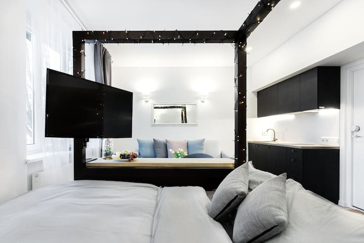 A nicely designed sleeping nook with a full double bed and a comfy mattress.