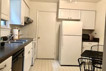 The kitchen is spacious. The door you see goes to the pantry