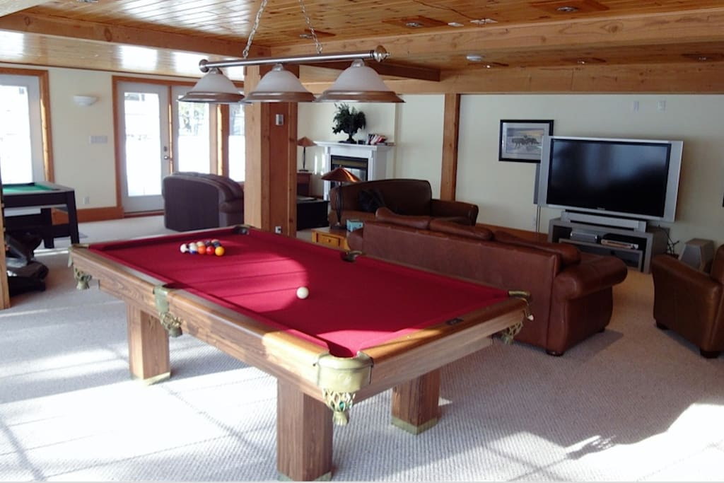 TV, Game room with pool, air hockey, and board games