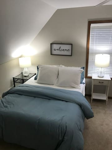 Bedroom #2 second floor * Queen bed * Dedicated work area *Desk lamp with USB cell phone charging port * Ceiling fan * Personal fan * Alarm clock * Clothes hangers and laundry basket
