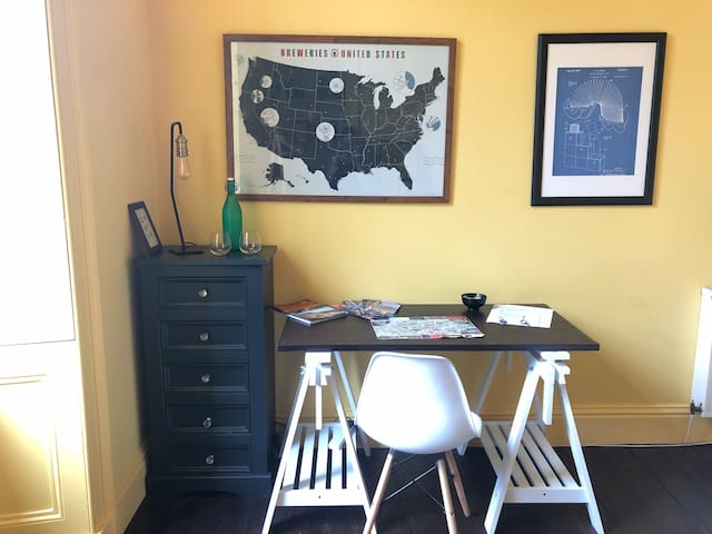 Need to get some work done? This desk is for you, complete with fast WiFi and lots of power points!