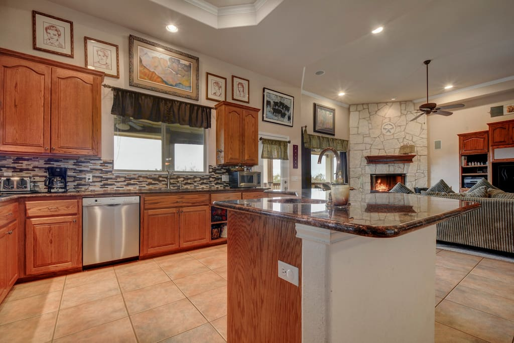 Large, practical and modern, the kitchen is a chef's dream with granite counters and full-size appliances